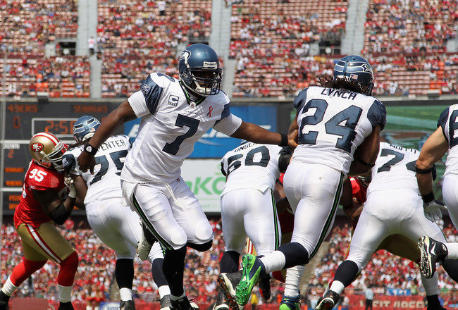 SAN FRANCISCO, CA - SEPTEMBER 11:  Tarvaris Jackson #7 of the Seattle Seahawks celebrates after the Seahawks scored a touchdown hands the ball off to  Marshawn Lynch #24 against the San Francisco 49ers during their season opener at Candlestick Park on Sep