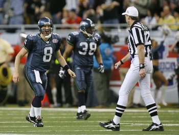 DETROIT - FEBRUARY 05:  Quarterback Matt Hasselbeck #8 of the Seattle Seahawks argues a call with referee Bill Leavy after throwing a pass out of bounds to receiver Darrell Jackson #82 in the second quarter against the Pittsburgh Steelers in Super Bowl XL