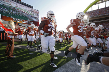 AUSTIN, TX - SEPTEMBER 10:  The Texas Longhorns team runs onto the field before the NCAA football game against the BYU Cougars on September 10, 2011 at Darrell K. Royal-Texas Memorial Stadium in Austin, Texas.  (Photo by Erich Schlegel/Getty Images)