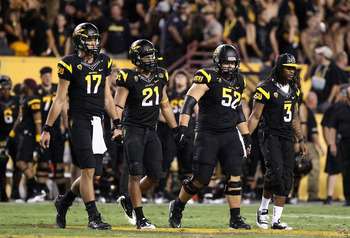 TEMPE, AZ - SEPTEMBER 09:  (L-R) Brock Osweiler #17, Colin Parker #21, Garth Gerhart #52 and Omar Bolden #3 of the Arizona State Sun Devils walk out to the overtime coin toss together during the college football game against the Missouri Tigers at Sun Dev