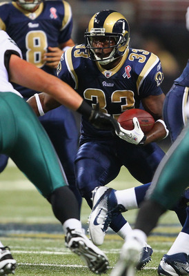 ST. LOUIS - SEPTEMBER 11: Cadillac Williams #33 of the St. Louis Rams rushes against the Philadelphia Eagles at the Edward Jones Dome on September 11, 2011 in St. Louis, Missouri. The Eagles beat the Rams 31-13. (Photo by Dilip Vishwanat/Getty Images)