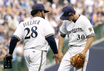 MILWAUKEE, WI - SEPTEMBER 11:  Prince Fielder #28 and Craig Counsell #30 of the Milwaukee Brewers celebrate their victory over the Philadelphia Phillies at Miller Park on September 11, 2011 in Milwaukee, Wisconsin. the Brewers beat the Phillies 3-2.(Photo