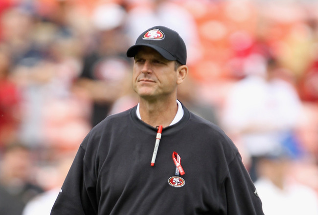 SAN FRANCISCO, CA - SEPTEMBER 11:  Head coach Jim Harbaugh walks on the field before their season opener against the Seattle Seahawks at Candlestick Park on September 11, 2011 in San Francisco, California.  (Photo by Ezra Shaw/Getty Images)