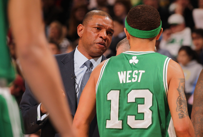 DENVER, CO - FEBRUARY 24:  Head coach Doc Rivers of the Boston Celtics directs Delonte West #13 against the Denver Nuggets during NBA action at the Pepsi Center on February 24, 2011 in Denver, Colorado. The Nuggets defeated the Celtics 89-75. NOTE TO USER