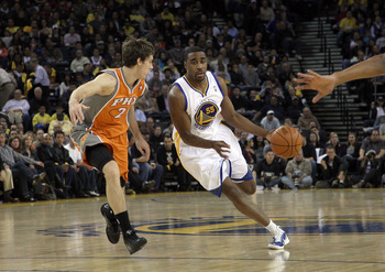 OAKLAND, CA - DECEMBER 02:  Reggie Williams #55 of the Golden State Warriors drives on Goran Dragic #2 of the Phoenix Suns at Oracle Arena on December 2, 2010 in Oakland, California. NOTE TO USER: User expressly acknowledges and agrees that, by downloadin