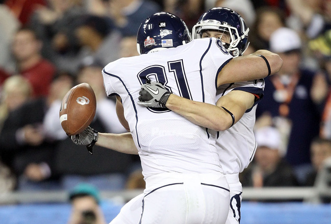 GLENDALE, AZ - JANUARY 01:  Robbie Frey #44 of the Connecticut Huskies reacts with teammate Nick Williams #31 after Frey scores on a 95-yard kick return for a touchdown in the third quarter against the Oklahoma Sooners in the Tostitos Fiesta Bowl at the U