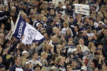 GLENDALE, AZ - JANUARY 01:  Connecticut Huskies fans cheer in the first half while taking on the Oklahoma Sooners during the Tostitos Fiesta Bowl at the Universtity of Phoenix Stadium on January 1, 2011 in Glendale, Arizona.  (Photo by Ronald Martinez/Get