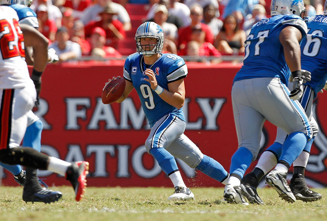 TAMPA, FL - SEPTEMBER 11:  Matthew Stafford #9 of the Detroit Lions scrambles during the season opener against the Tampa Bay Buccaneers at Raymond James Stadium on September 11, 2011 in Tampa, Florida.  (Photo by Mike Ehrmann/Getty Images)
