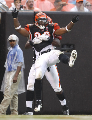 CLEVELAND, OH - SEPTEMBER 11:  Halfback Cedric Benson #32 of the Cincinnati Bengals celebrates with Chris Pressley #36 after scoring a touchdown against the Cleveland Browns during the season opener  at Cleveland Browns Stadium on September 11, 2011 in Cl