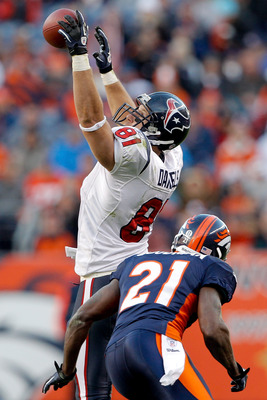 DENVER - DECEMBER 26:  Tight end Owen Daniels #81 of the Houston Texans makes a one-handed catch against cornerback Andre' Goodman #21 of the Denver Broncos during the third quarter at INVESCO Field at Mile High on December 26, 2010 in Denver, Colorado.