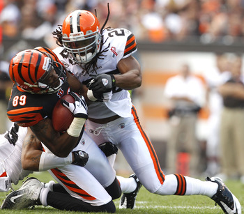 CLEVELAND, OH - SEPTEMBER 11: Defensive back Usama Young #28 of the Cleveland Browns hits wide receiver Jerome Simpson #89 of the Cincinnati Bengals during the season opener at Cleveland Browns Stadium on September 11, 2011 in Cleveland, Ohio.  (Photo by