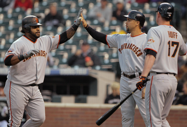 DENVER, CO - SEPTEMBER 15:  Pablo Sandoval (L) #48 of the San Francisco Giants is welcomed home by Carlos Beltran (C) #15 and Aubrey Huff #17 of the Giants after his two run homerun off of starting pitcher Jhoulys Chacin #45 of the Colorado Rockies in the