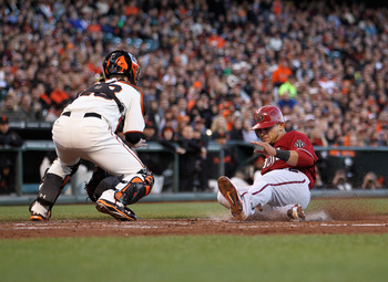 SAN FRANCISCO, CA - MAY 11:  Gerardo Parra #8 of the Arizona Diamondbacks slides safely past Buster Posey #28 of the San Francisco Giants to score on a hit by Henry Blanco #12 of the Arizona Diamondbacks in the second inning at AT&T Park on May 11, 2011 i