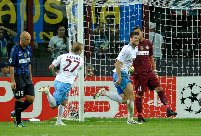 MILAN, ITALY - SEPTEMBER 14:  Ondrej Celustka of Trabzonspor As celebrates scoring the first goal during the UEFA Champions League group B match between FC Internazionale Milano and Trabzonspor As at Giuseppe Meazza Stadium on September 14, 2011 in Milan,