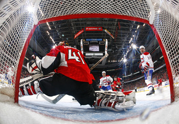 OTTAWA, CANADA - APRIL 07:  Brian Gionta #21 and Tomas Plekanec #14 of the Montreal Canadiens look on as teammate Michael Cammalleri #13 fires a puck over the shoulder of Craig Anderson #41 of the Ottawa Senators in a game at Scotiabank Place on April 7,