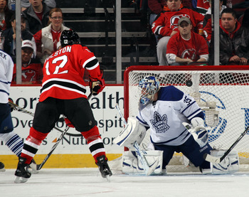 NEWARK, NJ - APRIL 06: Brian Rolston #12 of the New Jersey Devils takes the shot on Jean-Sebastien Giguere #35 of the Toronto Maple Leafs at the Prudential Center on April 6, 2011 in Newark, New Jersey.  (Photo by Bruce Bennett/Getty Images)