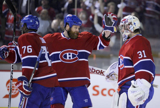 MONTREAL, CANADA - APRIL 26:  P.K. Subban #76; Paul Mara #22 and Carey Price #31 of the Montreal Canadiens celebrate a victory over the Boston Bruins in Game Six of the Eastern Conference Quarterfinals during the 2011 NHL Stanley Cup Playoffs at the Bell