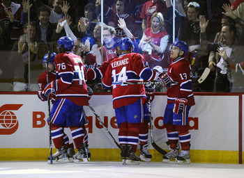 MONTREAL, CANADA - APRIL 26:  Brian Gionta #21, P.K. Subban #76, Tomas Plekanec #14, Scott Gomez #11 and Michael Cammalleri #13 of the Montreal Canadiens celebrate a goal against the Boston Bruins in Game Six of the Eastern Conference Quarterfinals during