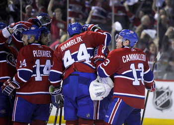 MONTREAL, CANADA - APRIL 26:  Tomas Plekanec #14;Roman Hamrlik #44;Carey Price #31 and Michael Cammalleri #13 of the Montreal Canadiens celebrate a victory over the Boston Bruins in Game Six of the Eastern Conference Quarterfinals during the 2011 NHL Stan