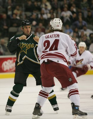 DALLAS - JANUARY 9:  Matthew Barnaby #77 of the Dallas Stars fights against Josh Gratton #24 of the Phoenix Coyotes on January 9, 2007 at the American Airlines Center in Dallas, Texas.  The Coyotes won 5-2.  (Photo by Ronald Martinez/Getty Images)