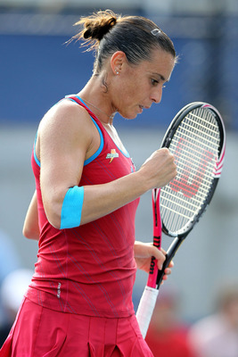NEW YORK, NY - SEPTEMBER 08:  Flavia Pennetta of Italy reacts against Angelique Kerber of Germany during Day Eleven of the 2011 US Open at the USTA Billie Jean King National Tennis Center on September 8, 2011 in the Flushing neighborhood of the Queens bor