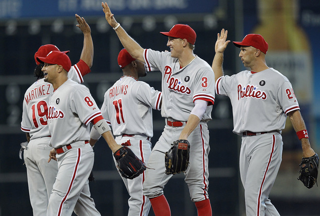 HOUSTON - SEPTEMBER 14:  Hunter Pence #3 and Raul Ibanez #29 of the Philadelphia Phillies high five Michael Martinez #19 after their 1-0 win over the Houston Astros at Minute Maid Park on September 14, 2011 in Houston, Texas.  (Photo by Bob Levey/Getty Im