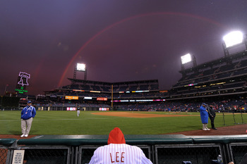 PHILADELPHIA, PA - SEPTEMBER 15: A fan sits in the stands as a rainbow shows overhead during a break in the games of a double header between the Florida Marlins and Philadelphia Phillies at Citizens Bank Park on September 15, 2011 in Philadelphia, Pennsyl