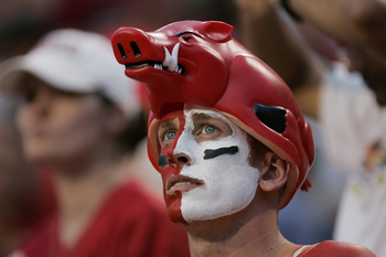 FAYETTEVILLE, AR - SEPTEMBER 2:  A male fan of the Arkansas Razorbacks looks on wearing face paint and a hog hat during the game against the University of Southern California Trojans on September 2, 2006 at Donald W. Reynolds Razorback Stadium in Fayettev
