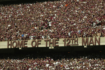 COLLEGE STATION, TX - SEPTEMBER 21:  Fans of the Texas A&M Aggies proudly stand in the Home of the 12th Man during the NCAA football game against the Virginia Tech Hokies on September 21, 2002 at Kyle Field in College Station, Texas. The Hokies won 13-3.