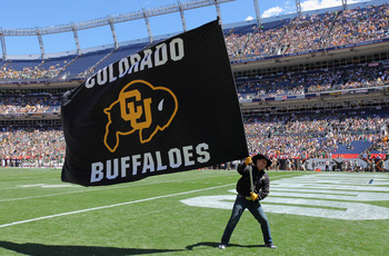 DENVER - SEPTEMBER 04:  A supporter of the Colorado Buffaloes waives a flag in the endzone against the Colorado State Rams in the Rocky Mountain Showdown at INVESCO Field at Mile High on September 4, 2010 in Denver, Colorado.  (Photo by Doug Pensinger/Get