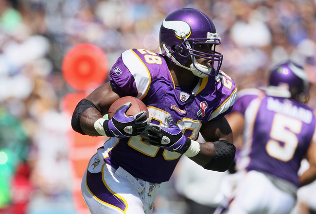 SAN DIEGO, CA - SEPTEMBER 11:  Running back Adrian Peterson #28 of the Minnesota Vikings carries the ball against the San Diego Chargers at Qualcomm Stadium on September 11, 2011 in San Diego, California.  (Photo by Jeff Gross/Getty Images)