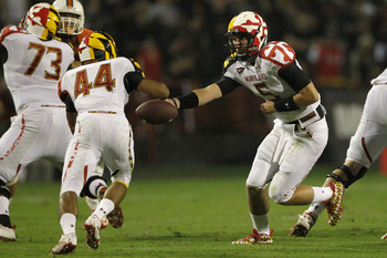 COLLEGE PARK, MD - SEPTEMBER 05: Quarterback Danny O'Brien #5 of the Maryland Terrapins hands the ball off to running back Justus Pickett #44 during the first half against the Miami Hurricanes at Byrd Stadium on September 5, 2011 in College Park, Maryland