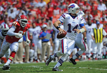 KANSAS CITY, MO - SEPTEMBER 11:  Quarterback Ryan Fitzpatrick #14 of the Buffalo Bills rolls out against pressure from linebacker Tamba Hali #91 of the Kansas City Chiefs during the second quarter on September 11, 2011 at Arrowhead Stadium in Kansas City,