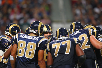ST. LOUIS - SEPTEMBER 11: Sam Bradford #8 of the St. Louis Rams huddles up against the Philadelphia Eagles at the Edward Jones Dome on September 11, 2011 in St. Louis, Missouri.  (Photo by Dilip Vishwanat/Getty Images)