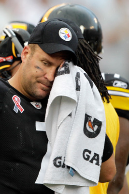 BALTIMORE, MD - SEPTEMBER 11:  Quarterback  Ben Roethlisberger #7 of the Pittsburgh Steelers wipes his face with a towel on the sidelines after throwing an interception to the Baltimore Ravens during the second half of the season opener at M&T Bank Stadiu