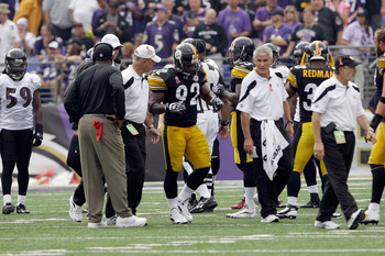 BALTIMORE, MD - SEPTEMBER 11:   James Harrison #92 of the Pittsburgh Steelers is helped off the field during the second half of the season opener against the Baltimore Ravens at M&T Bank Stadium on September 11, 2011 in Baltimore, Maryland.  (Photo by Rob