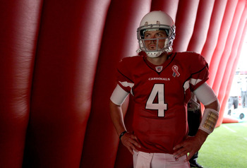 GLENDALE, AZ - SEPTEMBER 11:  Quarterback Kevin Kolb #7 of the Arizona Cardinals prepares to run out onto the field for the NFL season opening game against the Carolina Panthers at the University of Phoenix Stadium on September 11, 2011 in Glendale, Arizo