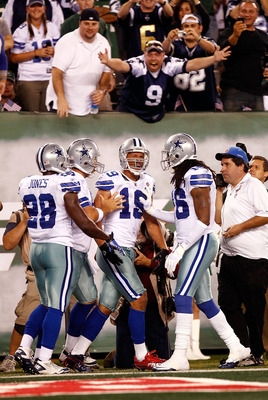 EAST RUTHERFORD, NJ - SEPTEMBER 11:  Miles Austin #19 of the Dallas Cowboysccelebrates with teammates after he caught a 36-yard touchdown in the third quarter against the New York Jets during their NFL Season Opening Game at MetLife Stadium on September 1
