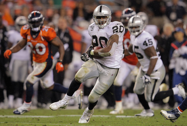 DENVER, CO - SEPTEMBER 12:  Darren McFadden #20 of the Oakland Raiders rushes for 47 yards to set up a fourth quarter touchdown against the Denver Broncos at Sports Authority Field at Mile High on September 12, 2011 in Denver, Colorado. The Raiders defeat