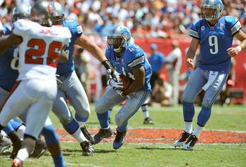 TAMPA, FL - SEPTEMBER 11:  Running back Jahvid Best #44 of the Detroit Lions rushes upfield against the Tampa Bay Buccaneers during the season opener at Raymond James Stadium September 11, 2011 in Tampa, Florida. (Photo by Al Messerschmidt/Getty Images)