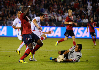 CARSON, CA - SEPTEMBER 02:  Goalkeeper Keylor Navas #1 of Costa Rica makes a save as teammate Jhonny Acosta #20 defends against Jozy Altidore #9 of the United States during the friendly soccer match at The Home Depot Center on September 2, 2011 in Carson,