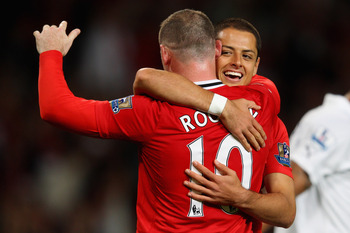 MANCHESTER, ENGLAND - AUGUST 22:  Wayne Rooney of Manchester United celebrates scoring his side's third goal with team mate Javier Hernandez during the Barclays Premier League match between Manchester United and Tottenham Hotspur at Old Trafford on August