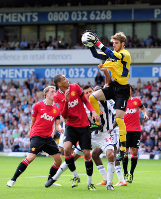 WEST BROMWICH, ENGLAND - AUGUST 14: Goalkeeper David De Gea of Manchester United claims a cross during the Barclays Premier League match between West Bromwich Albion and Manchester United at The Hawthorns on August 14, 2011 in West Bromwich, England.  (Ph