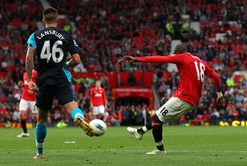 MANCHESTER, ENGLAND - AUGUST 28:  Ashley Young of Manchester United scores his second goal during the Barclays Premier League match between Manchester United and Arsenal at Old Trafford on August 28, 2011 in Manchester, England.  (Photo by Alex Livesey/Ge