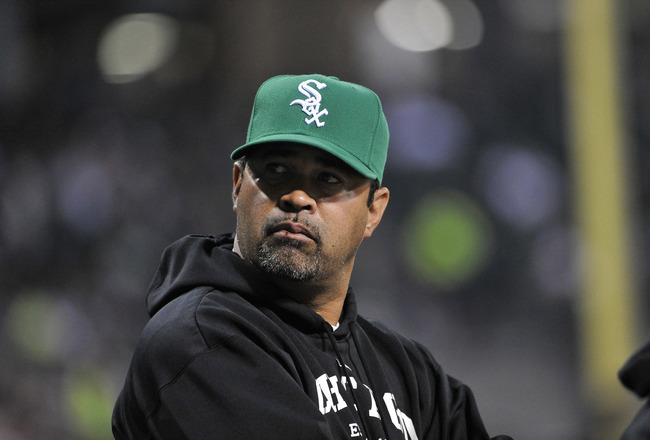 CHICAGO, IL - SEPTEMBER 09:  Manager Ozzie Guillen #13 of the Chicago White Sox stands in the dugout against the Cleveland Indians at U.S. Cellular Field on September 9, 2011 in Chicago, Illinois.  (Photo by Brian Kersey/Getty Images)