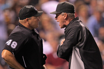 DENVER, CO - SEPTEMBER 09:  Manager Jim Tracy #4 of the Colorado Rockies has words with homeplate umpire Mark Carlson #48 after Carlson ejected Carlos Gonzalez #5 of the Colorado Rockies and subsequently ejecting Tracy in the fifth inning at Coors Field o