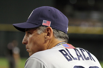 PHOENIX, AZ - SEPTEMBER 11:  Manager Bud Black of the San Diego Padres watches the MLB game against the Arizona Diamondbacks from the dugout  at Chase Field on September 11, 2011 in Phoenix, Arizona.  MLB players and coaches wore a an American flag on the