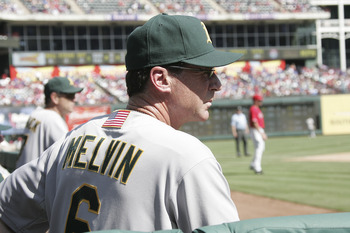 ARLINGTON, TX - SEPTEMBER 11: Manager Bob Melvin #6 of the Oakland Athletics watches his team during the game against the Texas Rangers at Rangers Ballpark in Arlington on September 11, 2011 in Arlington, Texas. (Photo by Rick Yeatts/Getty Images)
