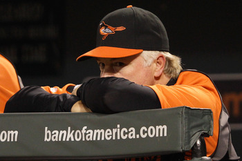 BALTIMORE, MD - SEPTEMBER 12: Manager Buck Showalter of the Baltimore Orioles looks on from the dugout during the seventh inning against the Tampa Bay Rays at Oriole Park at Camden Yards on September 12, 2011 in Baltimore, Maryland.  (Photo by Rob Carr/Ge