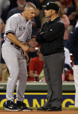 BOSTON, MA - AUGUST 30:  Manager Joe Girardi #28 of the New York Yankees argues in the ninth inning with Mark Wegner after Jarrod Saltalamacchia of the Boston Red Sox was hit by a pitch in the ninth inning on August 30, 2011 at Fenway Park in Boston, Mass